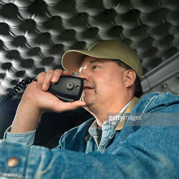 Truck Driver Talking on a Two-Way Radio