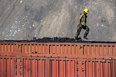 A truck driver walks atop of his load of coal at the Tavan Tolgoi coal deposit developed by Erdenes Tavan Tolgoi JSC a unit of Erdenes Mongol LLC in...