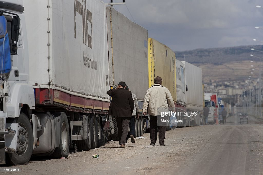 Truck drivers at the Turkish/ Syrian border on March 12, 2014, in Killis City, Turkey. The truck driver has been at the Kilis border now for 14 days, waiting to go through to the Syrian side. Truck drivers at the Turkish/ Syrian border near Kilis City wait 10-15 days to get their good through to the customs area where Syrian truckers can take the load to Syrian towns. Since ISIS moved out of the nearby Area of Azzaz more goods are collected by the Syrian trucks on the Bab Al Salame border.