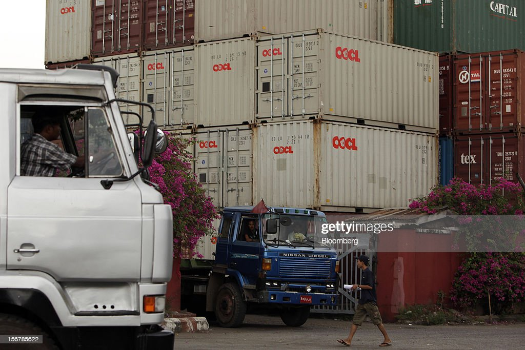 Truck drivers await loading at a shipping container depot in Yangon, Myanmar, on Tuesday, Nov. 20, 2012. Myanmar's growth outlook has improved 'substantially' amid political reforms, which are expected to lead to a large influx of foreign investment, the Organization for Economic Cooperation and Development (OECD) said on Nov. 18. Photographer: Dario Pignatelli/Bloomberg via Getty Images
