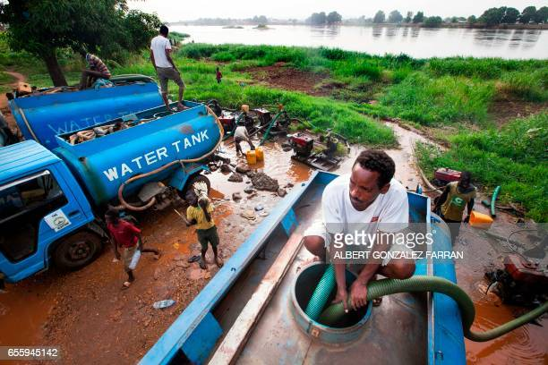 Truck drivers collect water directly from the Nile river on March 21 to distribute to residents for drinking consumption in Juba South Sudan...