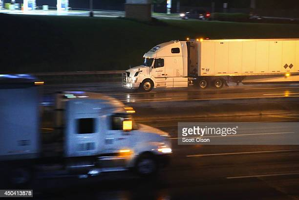Truck drivers navigate a raincovered highway on the outskirts of Chicago on June 10 2014 in Hinsdale Illinois Legislation introduced in the US Senate...