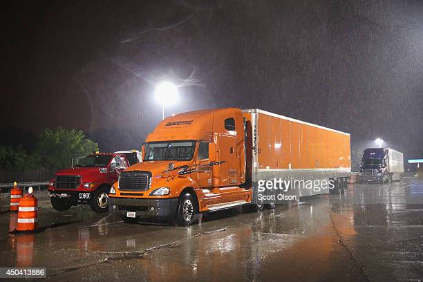 Truck drivers rest at a roadside oasis on a rainy evening on the outskirts of Chicago on June 10 2014 in Hinsdale Illinois Legislation introduced in...