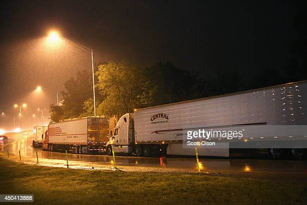 Truck drivers rest on a highway ramp on a rainy evening on the outskirts of Chicago on June 10 2014 in Hinsdale Illinois Legislation introduced in...