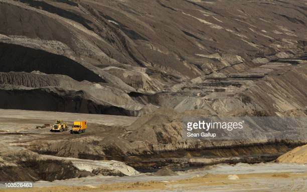 A truck drives among layers of deposited soil resulting from coal extraction in the Welzow openpit lignite coal mine on August 20 2010 near Drebkau...