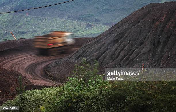 A truck drives at the Vale mine on April 2 2015 in Itabirito Minas Gerais state Brazil Some truck drivers at the site allegedly worked in slavelike...
