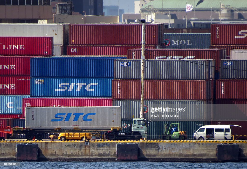 A truck drives away on a container wharf in Tokyo port on October 8, 2013. Japan's current account surplus was a sharply lower-than-expected 161.5 billion yen ($1.67 billion) in August.