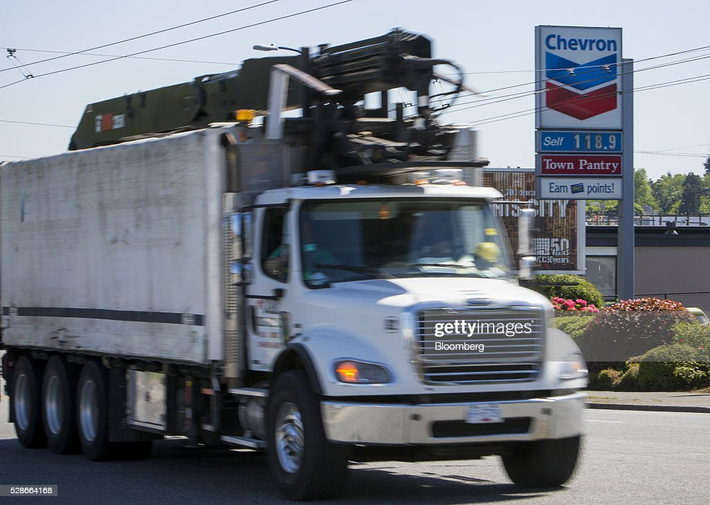 A truck drives past a Chevron Corp. gas station in Vancouver, British Columbia, Canada, on Friday, May 6, 2016. The worst wildfire in Alberta history is boosting Canadian crude prices as oil companies evacuate workers and shut in output. Photographer: Ben Nelms/Bloomberg via Getty Images