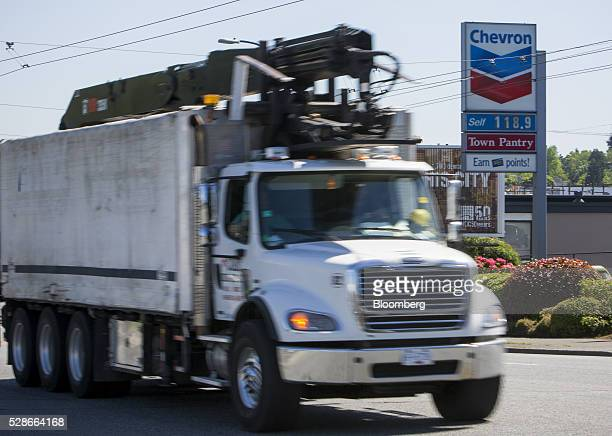 A truck drives past a Chevron Corp gas station in Vancouver British Columbia Canada on Friday May 6 2016 The worst wildfire in Alberta history is...