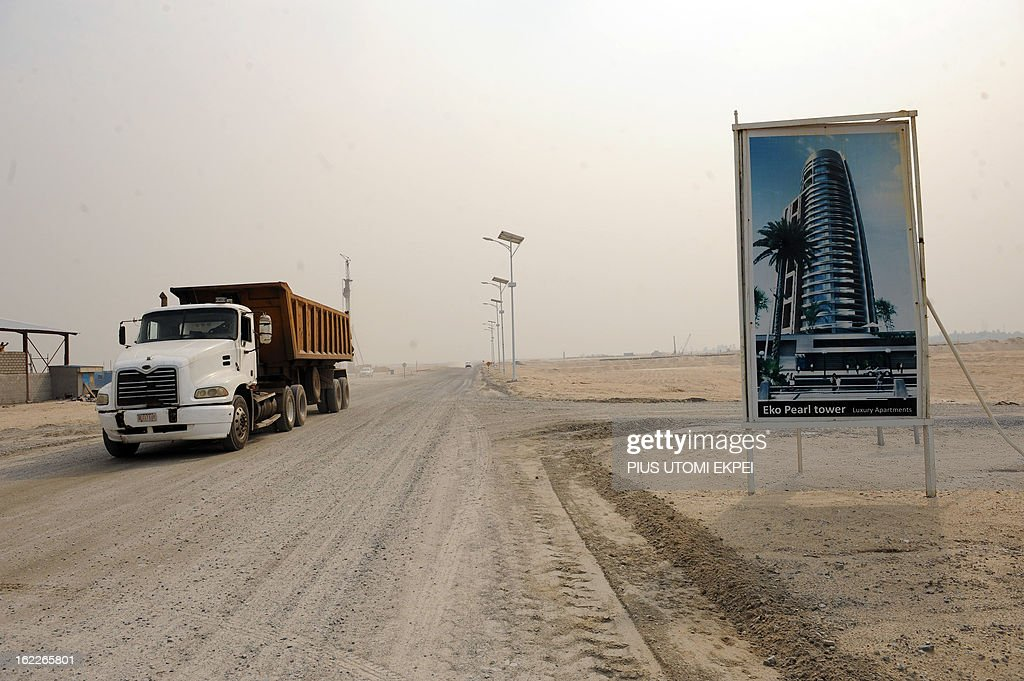 A truck drives past an advertising board for the Eko Pearl Tower, a building of the future Eko Atlantic, a new city born from the Altantic ocean in Lagos on January 31, 2013 in Lagos. Nigeria's President Goodluck Jonathan and former US President Bill Clinton dedicated on February 21, 2013 the new 5-million-square-metre Eko Atlantic City, which is to be the first modern smart city in Africa to be built on reclaimed land from the Atlantic Ocean.