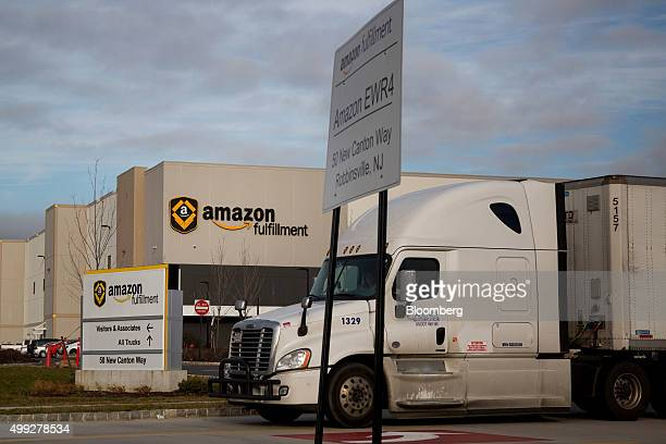 A truck drives past the Amazoncom Inc fulfillment center on Cyber Monday in Robbinsville New Jersey US on Monday Nov 30 2015 Online sales on Cyber...