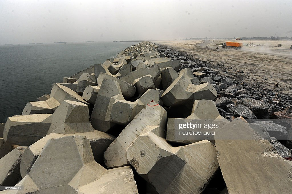 A truck drives past the three and a half kilometre long sea defence barrier called 'The Great Wall of Lagos' built to shield from coastal erosion Eko Atlantic, a new city born from the Altantic ocean in Lagos, on January 31, 2013. Nigeria's President Goodluck Jonathan and former US President Bill Clinton dedicated on February 21, 2013 the new 5-million-square-metre Eko Atlantic City, which is to be the first modern smart city in Africa to be built on reclaimed land from the Atlantic Ocean.