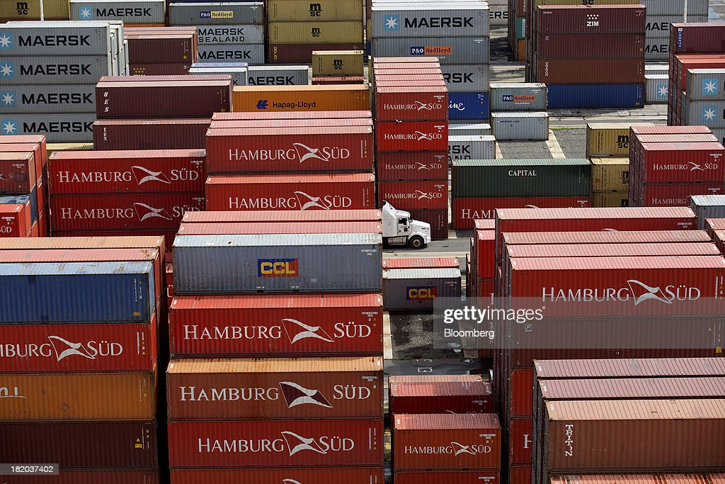 A truck drives through shipping containers stacked at the Port of Veracruz in Veracruz, Mexico, on Thursday, Sept. 26 2013. Mexico reported a preliminary trade deficit of $234.2 Million for August, according to the national statistics agency, known as Inegi. Photographer: Susana Gonzalez/Bloomberg via Getty Images