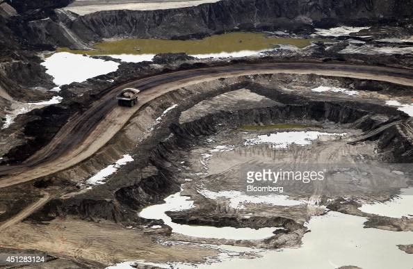 A truck drives through the Suncor Energy Inc mine in this aerial photograph taken above the Athabasca Oil Sands near Fort McMurray Alberta Canada on...