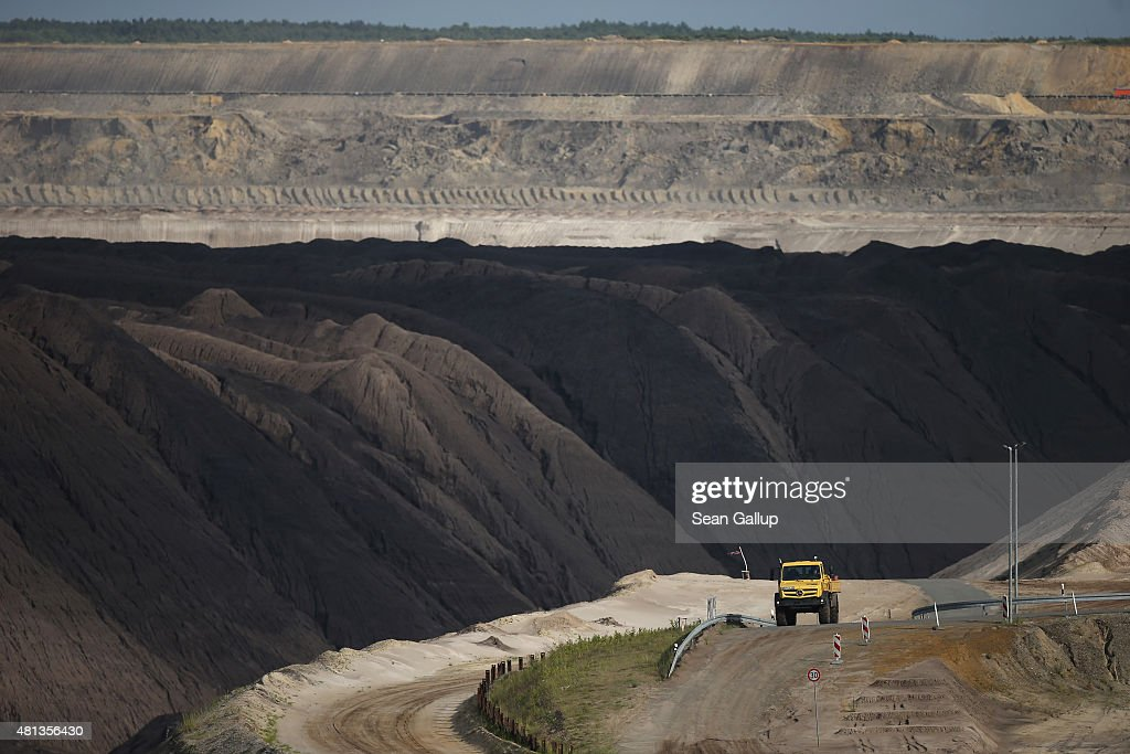A truck drives through the Welzow Sued openpit lignite coal mine on July 9 2015 near Welzow Germany The Welzow Sued mine feeds the Schwarze Pumpe...