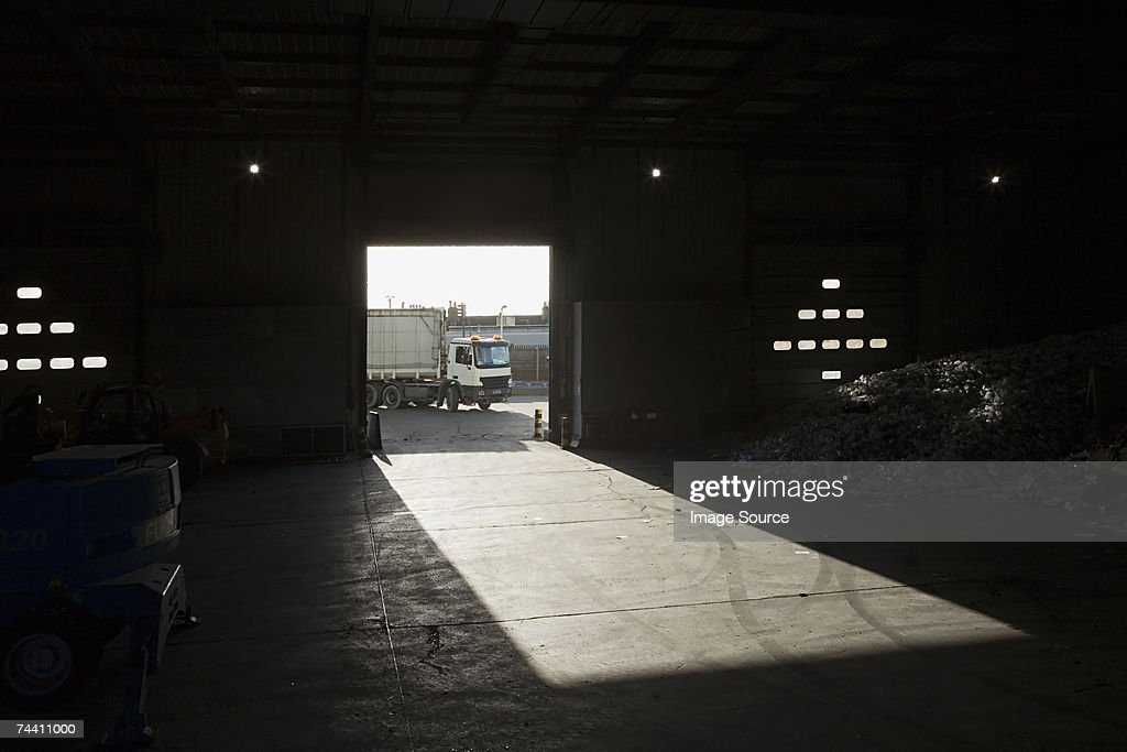 Truck driving into recycling depot : Stock Photo