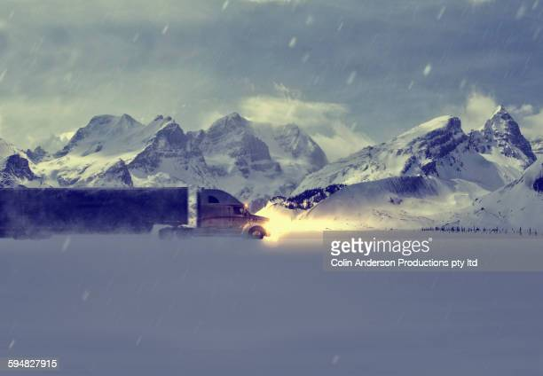Truck driving near snowy mountains