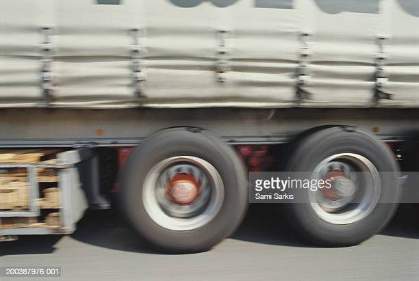 Truck driving on road, section (blurred motion)