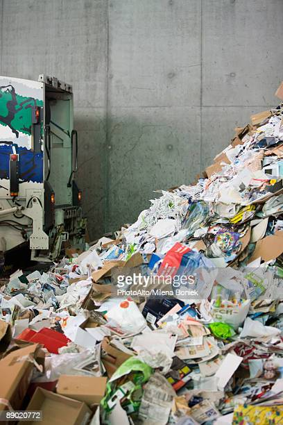Truck dumping paper in recycling center