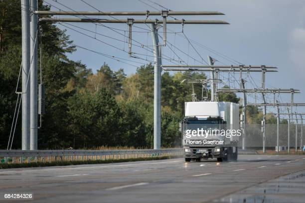 A truck electrically powered by overhead lines drives on a test track on April 11 2017 in Gross Doelln Germany