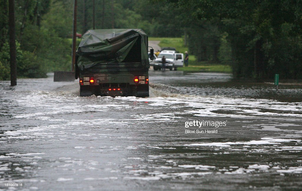 A truck from the 287th Engineering Battalion drives through a flooded section of Crane Creek Road in Kiln Mississippi on Thursday August 30 2012...