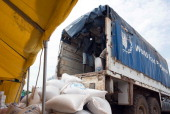A truck from the World Food Programm delivers bags of food at the UNMISS POC site on June 26 2014 in Tomping South Sudan WFP distributes food to...