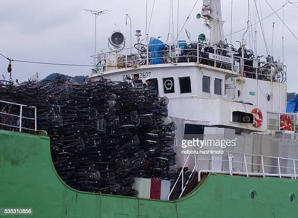 A truck full of scrap metal including old bicycles and fridges delivers its load to a North Korean cargo ship Last month Japanese customs discovered...