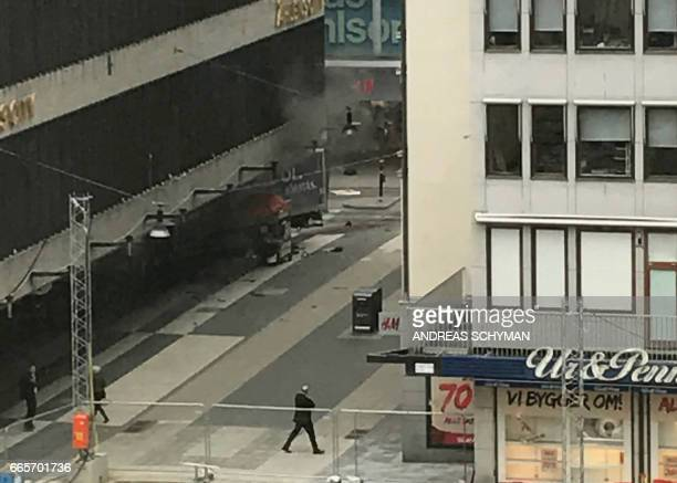 TOPSHOT A truck has crashed into the Ahlens department store at Drottninggatan in central Stockholm April 7 2017 News Agency / Andreas Schyman /...