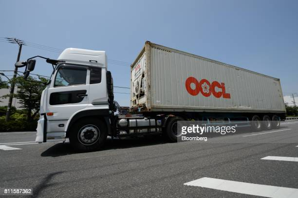 A truck hauls an Orient Overseas International Ltd container at shipping terminal in Tokyo Japan on Monday July 10 2017 Nippon Yusen KK Mitsui OSK...