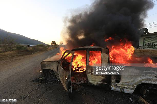 A truck in flames blocks a road in Nehuatzen Michoacan state Mexico during a protest of indigenous and community who demand participation in security...