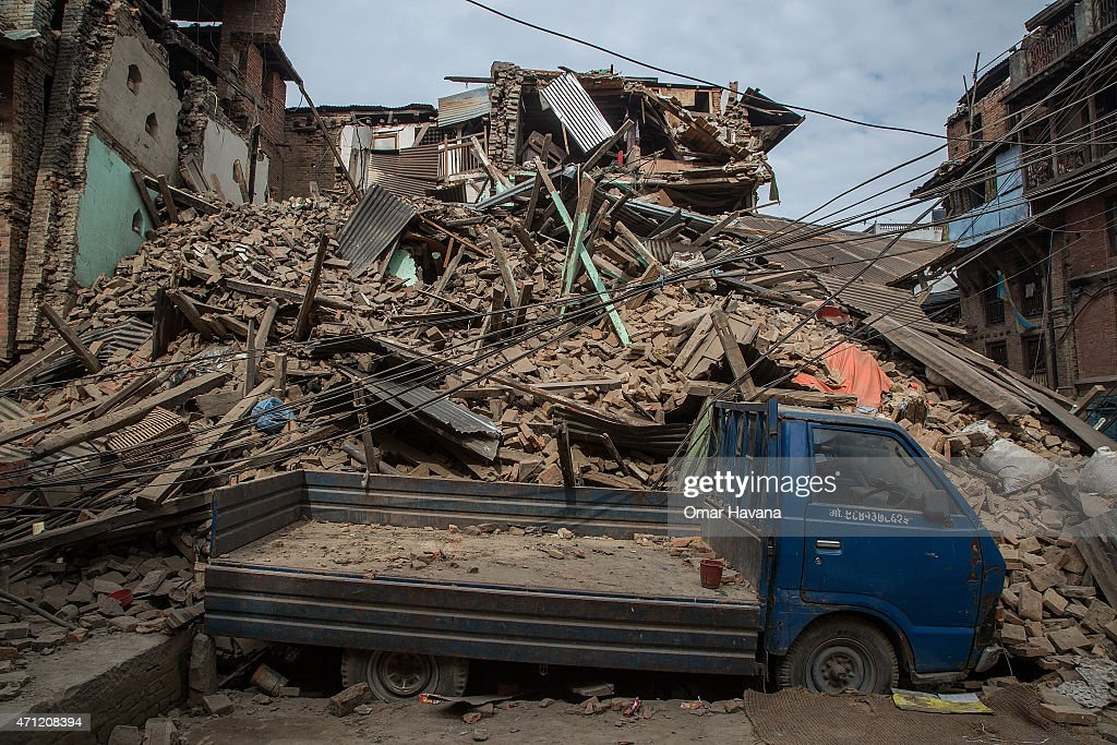 A truck is covered in debris from a collapsed building on April 26 2015 in Bhaktapur Nepal A major 78 earthquake hit Kathmandu midday on Saturday and...