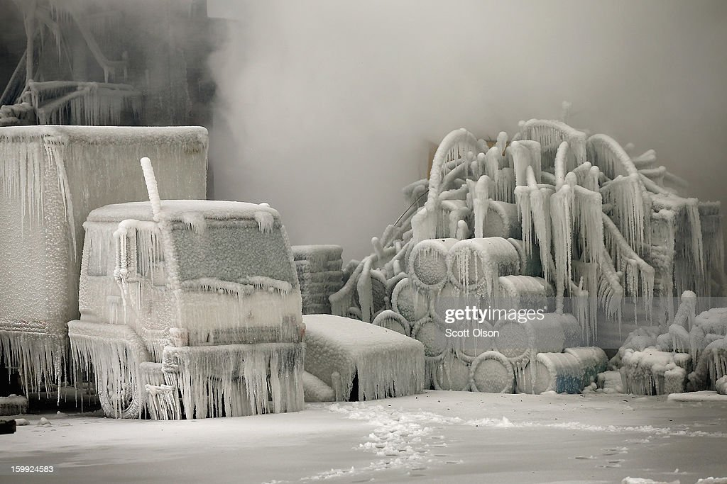 A truck is covered in ice as firefighters help to extinguish a massive blaze at a vacant warehouse on January 23, 2013 in Chicago, Illinois. More than 200 firefighters battled a five-alarm fire as temperatures were in the single digits.