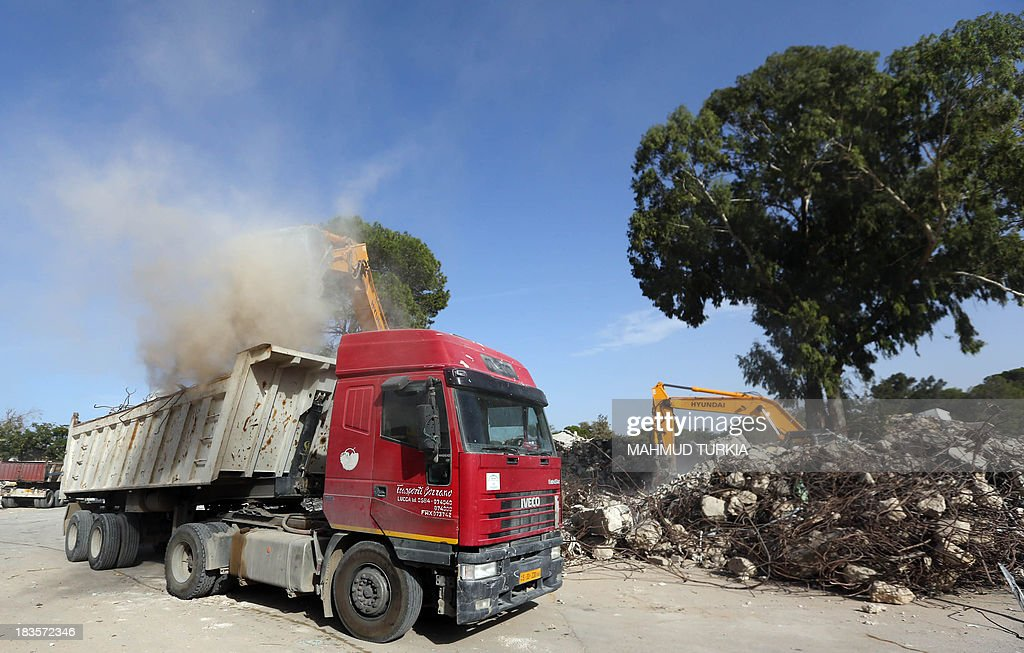 A truck is loaded with the rubble of former leader Moamer Kadhafi's Bab al-Azizia compound in Tripoli on October 7, 2013, which will be turned into a public recreation area for families, the Libyan Tourism Minister announced earlier this year. Bab al-Azizia 'The Splendid Gate' was a military barracks and compound, situated in the southern suburbs of the capital. It served as the main base for the Libyan leader Moamer Kadhafi until its capture by anti-Kadhafi forces on 23 August 2011, during the Battle of Tripoli.