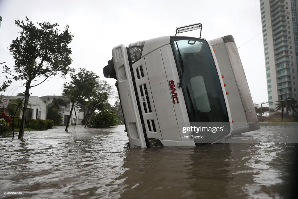 A truck is seen on its side after being blown over as Hurricane Irma passed through on September 10, 2017 in Miami, Florida. Hurricane Irma, which first made landfall in the Florida Keys as a Category 4 storm on Sunday, has weakened to a Category 2 as it moves up the coast.