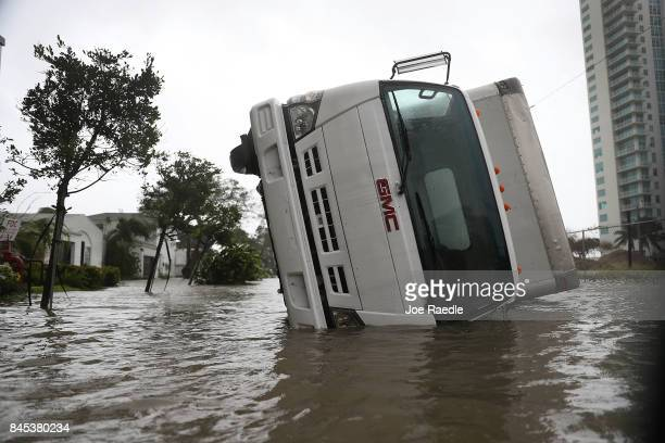A truck is seen on its side after being blown over as Hurricane Irma passed through on September 10 2017 in Miami Florida Hurricane Irma which first...