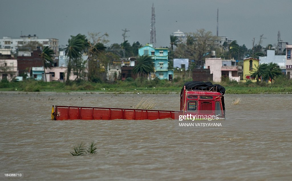 A truck is seen partially submerged in floodwaters following the cyclone in Gopalpur on October 13, 2013. Cyclone Phailin left a trail of destruction along India's east coast and up to seven people dead after the biggest evacuation in the country's history helped minimise casualties.