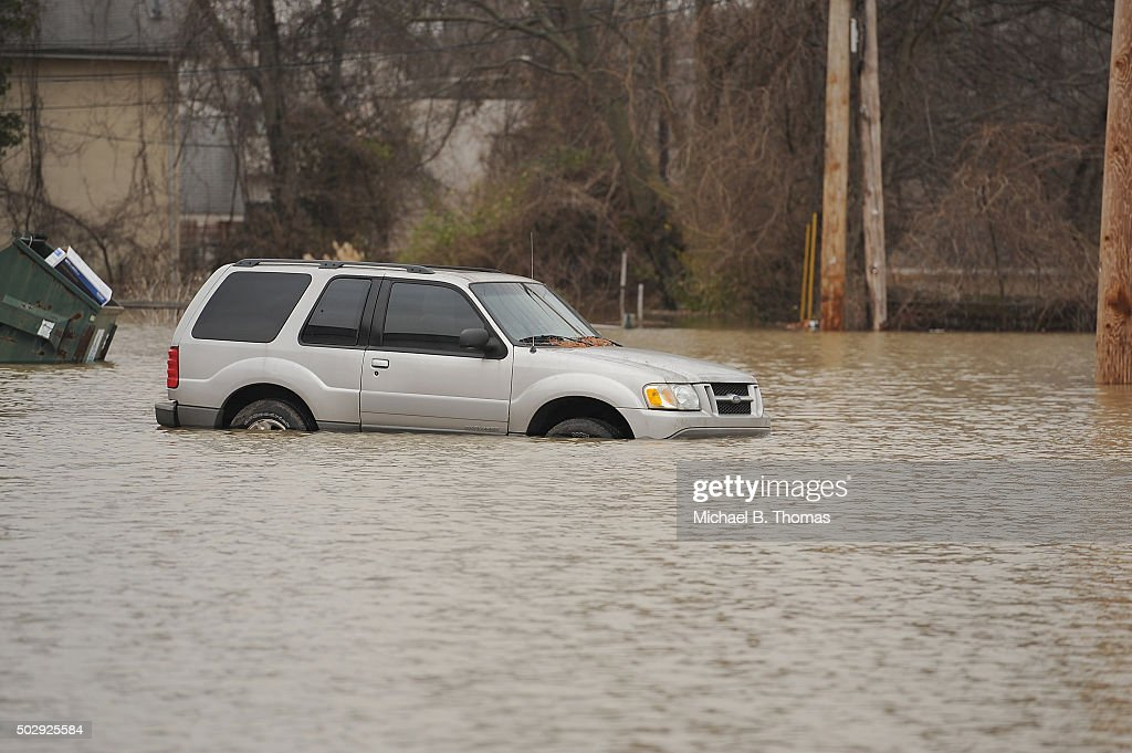 A truck is submerged in the floodwaters on a parking on December 30 2015 in Fenton Missouri The St Louis area and surrounding region experiencing...