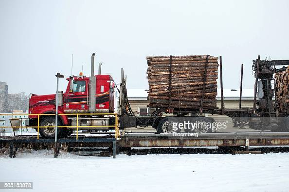 A truck is weighed before delivering a load of raw lumber at the Resolute Forest Products mill in Thunder Bay Canada Ontario on Friday Jan 8 2016...