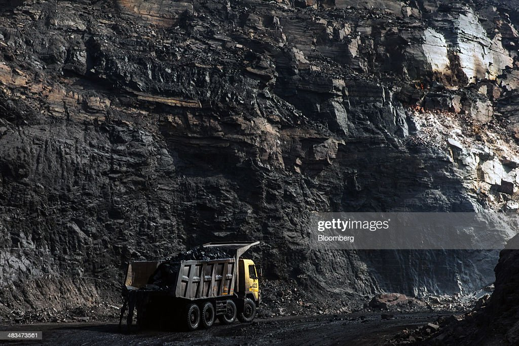 A truck laden with coal travels along a track road in Bastacolla Colliery in Jharia, Jharkhand, India, on Sunday, April 6, 2014. Coal India Ltd., the worlds largest producer, estimates on its website that the nation faces a supply deficit of 350 million tons by 2016-2017, thereby overtaking import demand from China, the worlds biggest coal consumer and producer. Photographer: Sanjit Das/Bloomberg via Getty Images