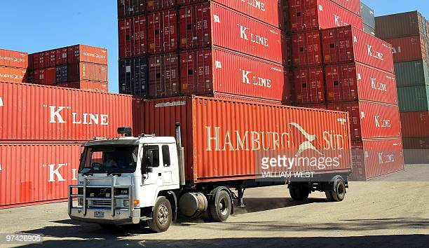 A truck leaves a container terminal in Melbourne on March 3 as Australia's economy shrugged off the first global contraction since World War II to...