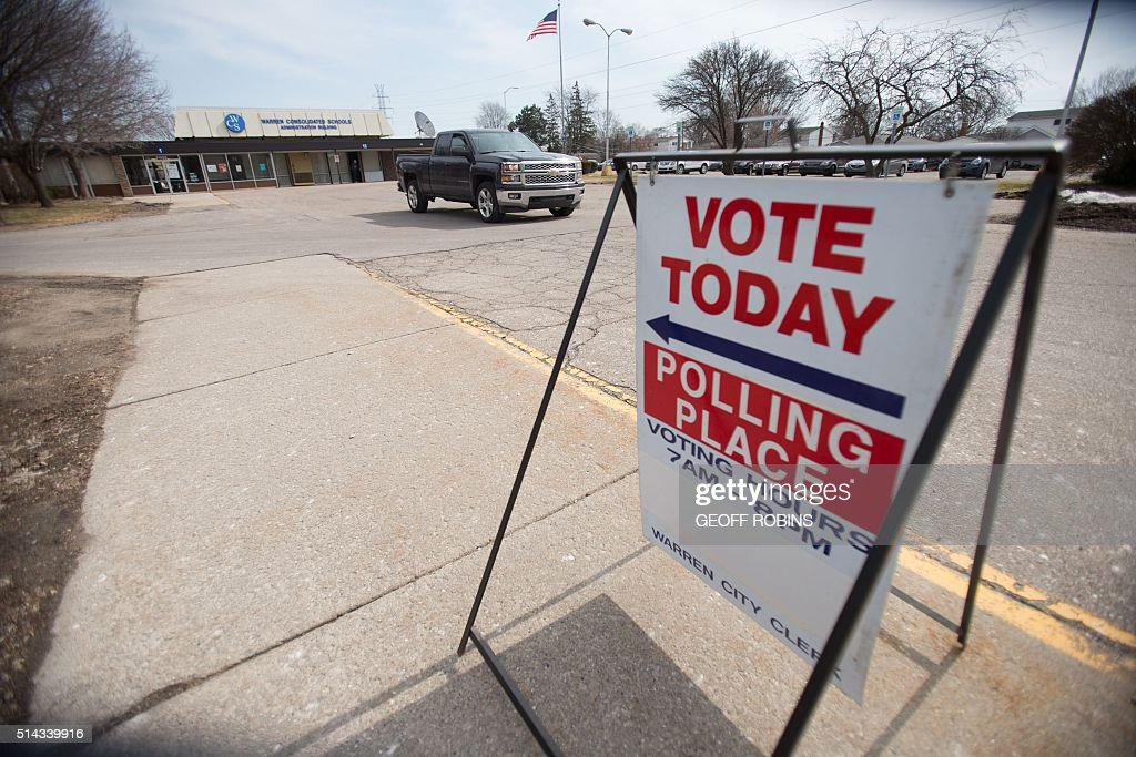 A truck leaves a polling place in Warren Michigan March 8 the day Michigan residents vote in their presidential primary US voters cast ballots in...