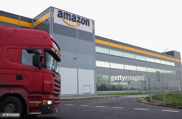 A truck leaves an Amazon distribution center in Kolbaskowo near Szczecin Poland on November 23 2017 Workers at Amazon the world's third largest...