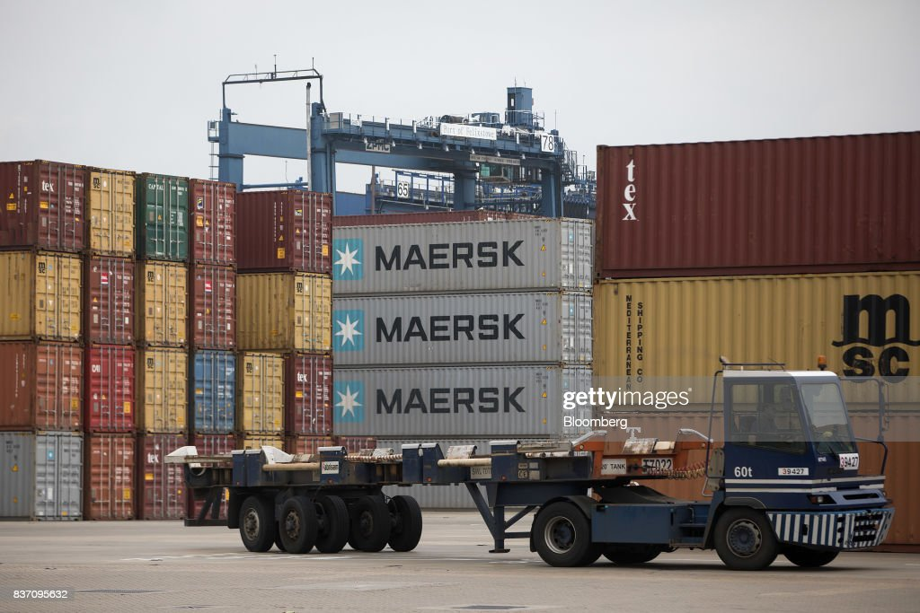 A truck moves past shipping containers, bearing the A.P. Moller-Maersk A/S logo, at the Port of Felixstowe Ltd., a subsidiary of CK Hutchison Holdings Ltd. in Felixstowe, U.K., on Tuesday, Aug. 22, 2017. U.K. exporters are still reaping the benefits of a weaker pound, but they're not sure how long the boost will continue as the country gets closer to withdrawing from the European Union. Photographer: Simon Dawson/Bloomberg via Getty Images