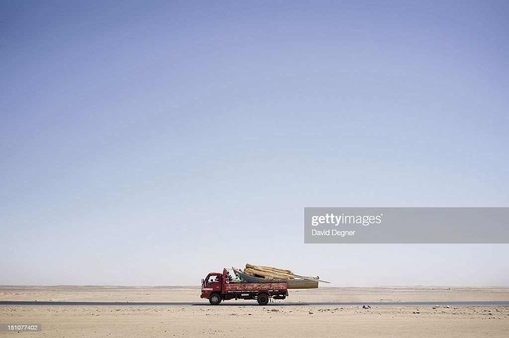 A truck of fishermen transport their boat through the desert for seasonal fishing south of the high damn, March 15, 2012. Abu Simbel is a one of the southern most villages in Egypt. It is most famous for its remains from Ancient Egypt, but it also draws Egyptians from across the country to work and make their dreams in its farms and jobs.