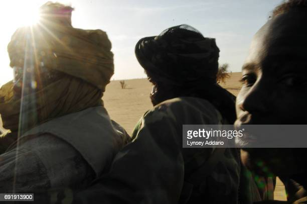 A truck of Sudanese rebels with the NRF ride along the Chad Darfur border as they head towards a former Sudanese government military camp where the...
