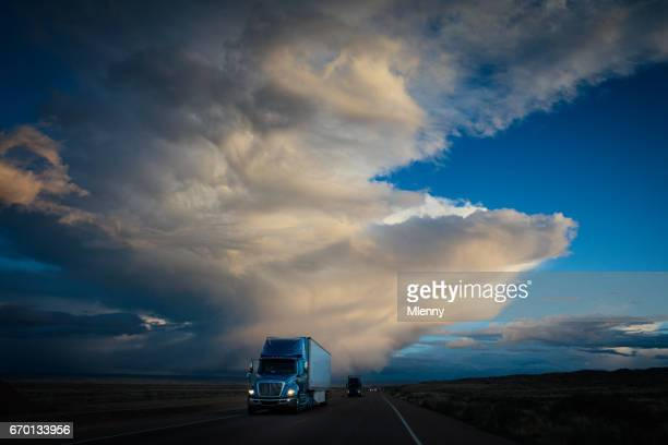Truck on American Highway Dramatic Twilight Sky