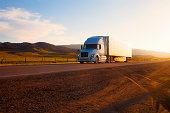 Truck on highway at sunset, California, USA.