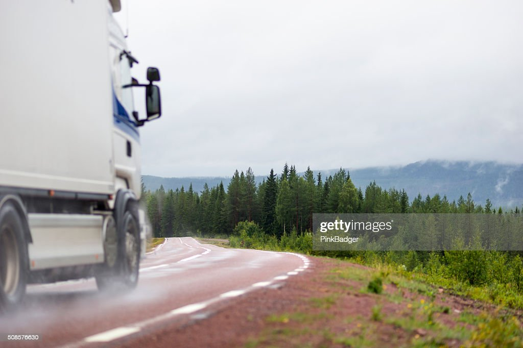 Truck on wet road : Stock Photo