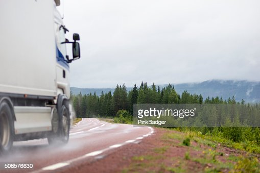 Truck on wet road : Bildbanksbilder