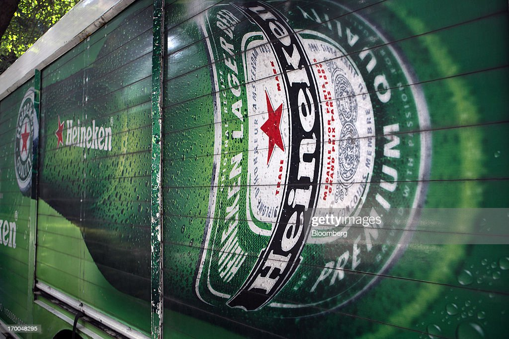 A truck operated by Cuauhtemoc-Moctezuma, a subsidiary of Heineken NV, is parked while making deliveries in Mexico City, Mexico, on Thursday, June 6, 2013. Heineken NV and Grupo Modelo SAB, the dominant brewers in Mexico with brands such as Dos Equis and Corona, are nearing the end of an almost three-year-old government antitrust probe. Photographer: Susana Gonzalez/Bloomberg via Getty Images